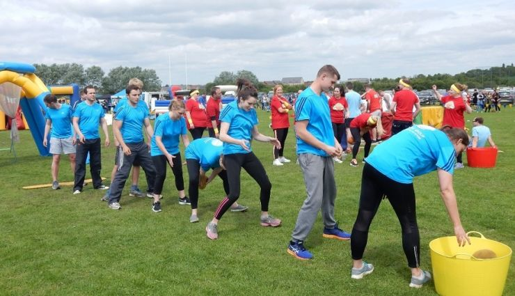 The Rolton Group team taking on one of the fun day challenges.